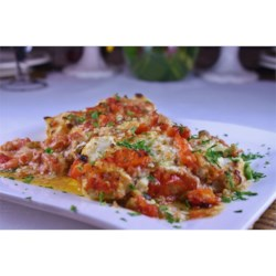 Baked Cod with Boursin Herb Cheese Recipe - Bake cod fillets with a savory topping of herbed Boursin cheese, diced tomatoes seasoned with garlic, onions, and peppers, and Parmesan cheese, and enjoy a fast and easy seafood dish.