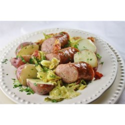 Kielbasa and Cabbage Recipe - Cabbage cooked in bacon drippings and seasoned with garlic, red pepper flakes and caraway seeds makes a cozy nest for smoked Polish-style sausage in this homey, hearty, and satisfying supper.