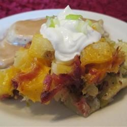 Hot German Potato Salad Casserole Recipe - This hot potato salad in casserole form has a creamy mayonnaise dressing with bits of bacon and celery throughout. The melted Cheddar cheese makes this dish a crowd pleaser.