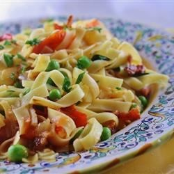 Pasta with Bacon and Peas Recipe - Pasta in a red sauce with bacon and peas.