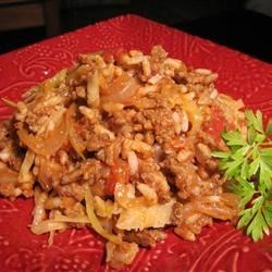 Cabbage Roll Casserole Recipe and Video - This casserole combines chopped cabbage with ground beef, tomato sauce, and rice. Preparation is much simpler than for standard stuffed cabbage rolls.