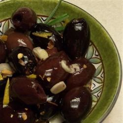 Orange and Rosemary Baked Olives Recipe - Olives are baked with wine, orange zest, rosemary and garlic in this lovely appetizer or hors d'oeuvre.