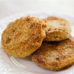 Frugal Fried Green Tomatoes Recipe - Only four ingredients are needed to make crunchy fried green tomatoes. They make a tasty side dish to any meal.