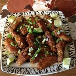 Garlic-Ginger Chicken Wings Recipe - A deliciously sticky, ginger, and garlic glaze coats oven-baked chicken wings in this recipe perfect for football snacks.