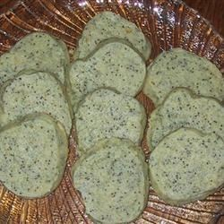 Poppy Seed Cookies III Recipe - Add these speckled treats to your holiday cookie trays. Easy to make ahead and freeze.