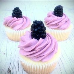 Lemon Cupcake with Blackberry Buttercream Recipe - A simple from-scratch lemon cupcake has blackberry buttercream frosting. This cupcake is a refreshing hit! Garnish each cupcake with a blackberry or a pinch of lemon zest.