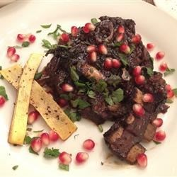 Lamb Braised in Pomegranate Recipe - Lamb shoulder chops braised in pomegranate juice, then topped with pumpkin seeds and mint: the perfect dish for a cold winter's night.
