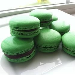 Added creme de menthe oil to the macaroons and stuffed them with chocolate ganache