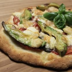 Chicken Avocado Pizza Recipe - A deliciously different California inspired pizza made with avocado spread in place of pizza sauce, and topped with chicken and Monterey Jack cheese. Great for a light meal.