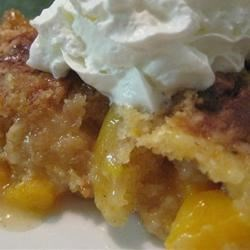 Peach Cobbler Dump Cake I Recipe - Yellow cake mix and peaches canned in heavy syrup are the primary components in this simple dump cake recipe.