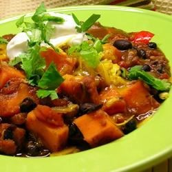 Sweet Potato and Black Bean Chili Recipe and Video - This hearty vegetarian chili includes roasted sweet potatoes and black beans, along with spicy, flavorful seasonings such as chili powder, jalapenos, and cocoa powder.