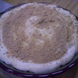 Peanut Butter Pie VII Recipe - A creamy egg custard filling is poured over a crumble of confectioners ' sugar and peanut butter that 's then crowned with a stiff and glossy meringue. This heavenly creation is slipped into the oven and baked until the meringue is golden.