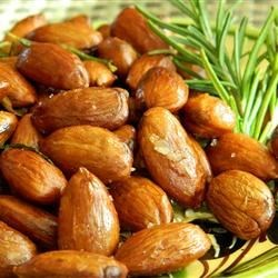 Rosemary and Garlic Infused Oven Roasted Almonds Recipe - Roasted almonds are tossed with rosemary and garlic-infused olive oil for a fragrant and savory snack that everyone will enjoy.