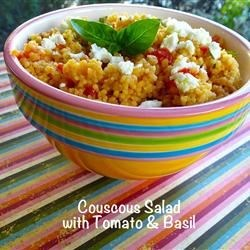 Couscous Salad with Tomato and Basil Recipe - Quickly-cooked couscous is tossed with the tried-and-true combination of tomato and basil in this hot (or cold) salad.