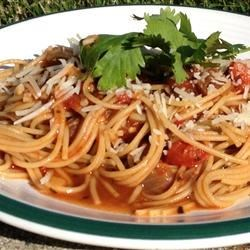 Pasta Pomodoro Recipe and Video - Easy and light pasta with tomatoes and garlic. Cooked chicken breast chunks or shrimp can also be added to sauce for a great main dish!
