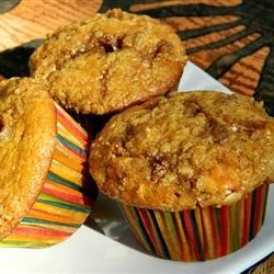 White Chocolate Cranberry Pumpkin Muffins Recipe - White chocolate chips and dried cranberries are folded into the pumpkin muffin batter creating a colorful twist to this sweet muffin.