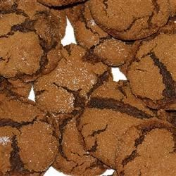 Molasses Sugar Cookies Recipe - These chewy cookies are made with molasses, brown sugar and shortening.  To achieve the chewy texture, allow cookies to cool on a flat surface rather than a rack.