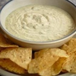 Creamy Jalapeno Ranch Dip Recipe - Fresh jalapeno pepper and canned green chilies give spice to this buttermilk and mayonnaise-based creamy dip.