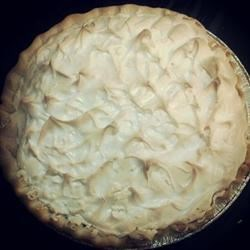 Rich Chocolate Pie Recipe -  Cocoa is mixed and heated with egg yolks, sugar, evaporated milk, butter, vanilla and flour, to make a rich chocolate pudding. Then this filling is poured into a deep-dish crust, topped with meringue and baked.