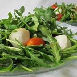 Arugula Caprese Salad Recipe - Peppery arugula adds a zingy bite to this fresh tomato and mozzarella salad.