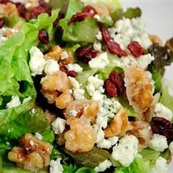 Missy's Candied Walnut Gorgonzola Salad Recipe - A yummy, easy salad with candied walnuts, cranberries, Gorgonzola cheese, mixed greens, and a raspberry vinaigrette. It's always a big hit and is requested by my friends and family constantly!