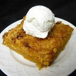 Rich Pumpkin Dessert Recipe - A spiced pumpkin layer is topped with yellow cake mix and pecans for a rich pumpkin pie alternative for the Thanksgiving table.