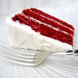 Red Velvet Cake Recipe - This classic red velvet layer cake is made tender with buttermilk. It's topped with a fluffy cooked white icing.