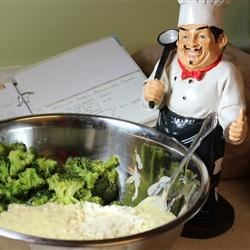 Chef Luigi mixing Broccoli and Rice Casserole