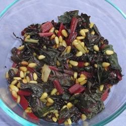 Spanish-Style Swiss Chard with Raisins and Pine Nuts Recipe - A simple side dish with wilted Swiss chard stir-fried with pine nuts and raisins delivers a Spanish flair to your dinner table.