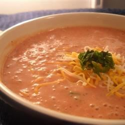 Tomato Blue Cheese Soup Recipe - A blend of blue cheese and cream cheese makes this tomato soup extra rich and flavorful. Serve it with some crusty bread for dunking.
