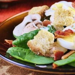 Spinach, Bacon, and Mushroom Salad Recipe - Fresh spinach and mushrooms are tossed with hard-cooked eggs and bacon in this salad.