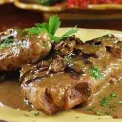 Veal Marsala Recipe - Veal cutlets are pounded thin, breaded and cooked in a skillet with butter, mushrooms and Marsala wine -- simple and elegant.