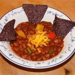 Vegetarian Pumpkin Chili Recipe - Black beans and pumpkin puree are nicely spiced and simmered together for a Halloween-inspired, hearty soup.