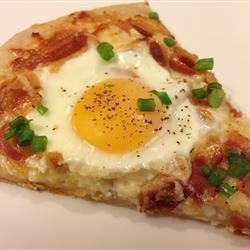 Dad's Breakfast Pizza Recipe - This breakfast pizza, made with refrigerated biscuit dough, is topped with eggs, bacon, and Cheddar cheese.