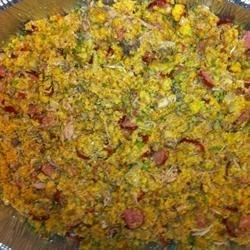 Mama's Cornbread and Sausage Turkey Dressing Recipe - This delicious dressing is bursting with crumbled cornbread, pork sausage, onions, garlic, and parsley, and is irresistible for a Thanksgiving feast!