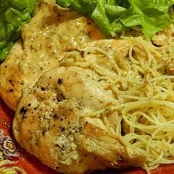 Chicken Ranch Dijon Recipe - Chicken breasts in a ranch and Dijon mustard sauce are served atop angel hair pasta for a main dish that's tasty and quick.