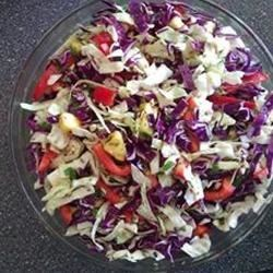 Fiesta Slaw Recipe - This summer slaw combines fresh crunchy cabbage and red peppers with sweet, tangy pineapple, made zesty with chipotle pepper, garlic, and lime juice.