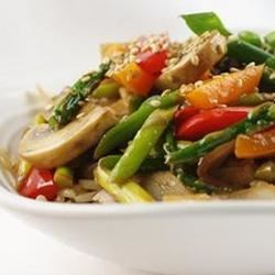 Stir Fried Sesame Vegetables with Rice Recipe - Asparagus, red bell pepper, onion, mushrooms, ginger and garlic stir-fried in peanut oil and garnished with toasted sesame seeds.  Serve over rice.