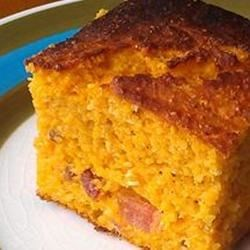 Bacon Sweet Potato Cornbread Recipe - Whip up a batch of corn bread the old-fashioned way by baking it in a cast-iron skillet. This version has mashed sweet potatoes and bacon for a sweet and savory taste.