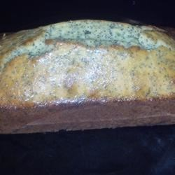 Delicious Moist Poppy Seed Cake Recipe - A rich moist lemony cake, soaked with a rich lemon syrup after baking. This cake will last a week at room temperature, and it freezes well. It is also very good sliced and toasted.