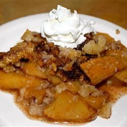 Apple Crisp I Recipe - Apple slices are dusted with cinnamon, piled into an 8-inch square pan, and topped with a crumbly flour, sugar and egg mixture, with a bit of baking powder stirred in. Then it 's dusted with sugar and cinnamon, and slipped into the oven.