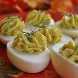 Classic Savory Deviled Eggs Recipe - Hard-cooked eggs are stuffed with a creamy blend of mayonnaise, Dijon mustard and rice wine vinegar. Fresh dill and garlic powder add a delightful flavor.
