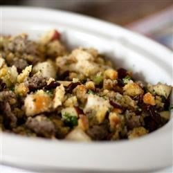 Awesome Sausage, Apple and Cranberry Stuffing Recipe and Video - Freshly toasted bread cubes, turkey sausage, chopped apples and dried cranberry combine to create a tasty fruited stuffing for a 10-pound turkey.