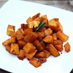 Rosemary Roasted Butternut Squash Recipe - Butternut squash roasted with fresh rosemary and garlic makes a satisfying side dish, especially during the fall months.