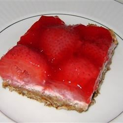 Pretzel Salad Recipe - This is an easy and decorative three layer salad consisting of a pretzel crust, a cream cheese center and a strawberry Jell-O topping. It's just plain delicious.