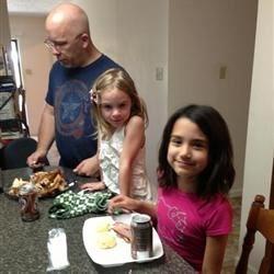 The kids stealing turkey as it was being cut