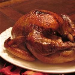 Herb-Glazed Roasted Turkey Recipe - A whole turkey is brushed and basted with a honey-butter glaze flavored with thyme, sage, and basil. It's the star of a holiday table.