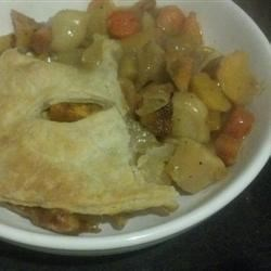 Curry Root Vegetable Pot Pie Recipe - Roast your favorite root vegetables and toss them in a curried broth for the filling of a puff pastry-topped pot pie. Use any combination of vegetables for a colorful and warm dinner.