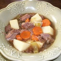 Healthier Marie's Easy Slow Cooker Pot Roast Recipe - Made healthier by increasing the amount of fresh carrots, onion, potatoes, and celery, this chuck roast is slow cooked for several hours, for a juicy and tender meal.