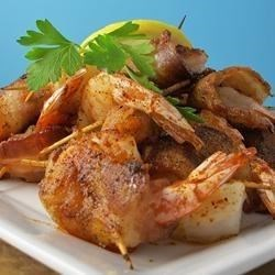 Bacon Wrapped Barbeque Shrimp Recipe - As though shrimp wrapped in crispy bacon were not tempting enough, a touch of barbeque seasoning spices things up just for fun. This makes dinner for two or appetizers for four.
